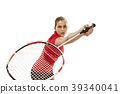 Young woman playing badminton over white 39340041