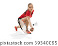 Young woman playing badminton over white 39340095