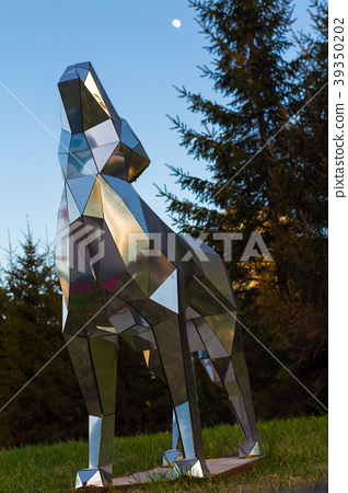 A statue of a wolf made of glass howling at the 39350202