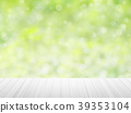wood table top on green bokeh abstract background 39353104