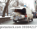 Carpet delivery van with open trunk. Large bulky 39364217
