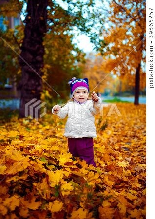 Young girl standing in foliage 39365257