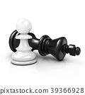 White pawn standing over fallen black king 39366928