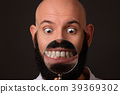 bald man showing his teeth via magnifying glass on 39369302