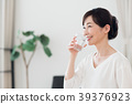 Middle aged woman drinking mineral water 39376923