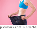 woman wear jeans and show weight loss  39386764