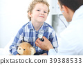 Doctor and child patient. Physician examines 39388533