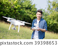 asia man play drone in the outdoor 39398653