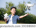 asia man play drone in the outdoor 39398660