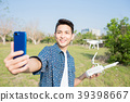 man with drone 39398667