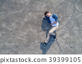 aerial shot of man feel upset and lying on  floor 39399105