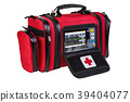Modern portable biphasic defibrillator in red bag 39404077