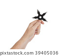 Hand is throwing ninja shuriken 39405036
