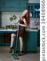 Beautiful red-haired woman with a mop. 39408966