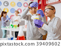 Cheerful boy showing his friend chemical reaction 39409602