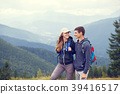 Young happy couple with backpack in mountains 39416517
