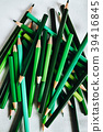 Pile of green coloured pencils   39416845