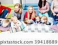 Moms take care of children 39418689