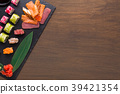 Set of assorted sushi, maki and rolls on rustic 39421354