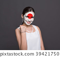 Young woman with Japan flag painted on her face 39421750