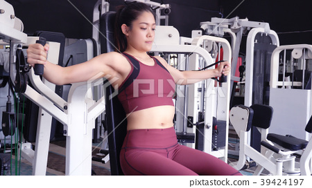 women want to have a beautiful body with fitness. 39424197