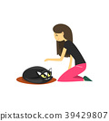 Young woman sitting on the floor and stroking her 39429807