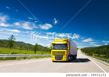 Yellow truck on a road 39431232