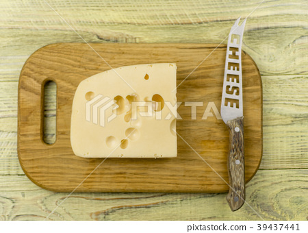 Cheese on cutting board  and knife  39437441