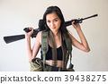 Female soldier with M16 rifle gun 39438275