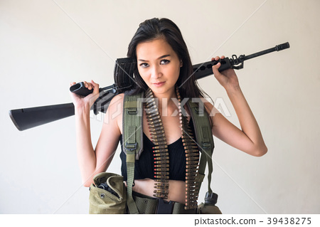 Female soldier with M16 rifle gun 39438275
