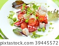 Marinated octopus and scallops with basil sauce. Italian-style appetizer, hors d'oeuvres. With white wine. 39445572