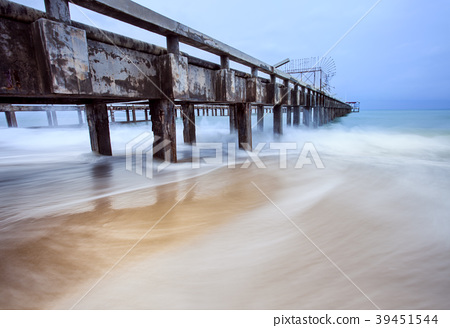 old ship pier and sea wave in storming season 39451544