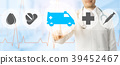 Doctor points at ambulance and emergency icon 39452467