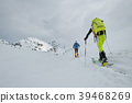 Ski mountainers in the shadows of the mountains. 39468269