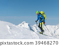 Ski mountainers in the shadows of the mountains. 39468270