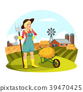 Woman with pitchfork in front of field with hay 39470425