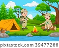 Cartoon scout with tent and camp fire 39477266