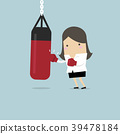 Businesswoman wearing boxing gloves and punching. 39478184