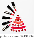 Lipstick on white background top view 39490594