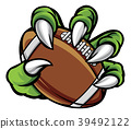 Monster animal claw holding American Football Ball 39492122