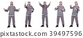 Prison inmate isolated on the white background 39497596