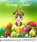 Cute little rabbit with Easter eggs in a field 39503097
