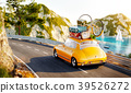 Cute little retro car with suitcases 39526272