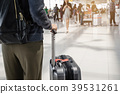 Young woman traveler walking in airport 39531261