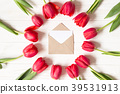 Envelope and frame of red tulips 39531913