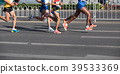 Legs of marathon runners running on city road 39533369