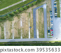 Aerial of a huge parking lot in the green 39535633
