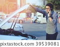 Angry man Stand front a broken car calling  39539081