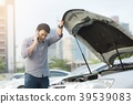 Angry man stand in front a broken car calling   39539083