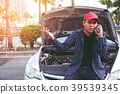 Angry man Stand front a broken car  39539345